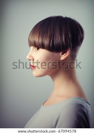 young beautiful woman portrait with depth of field effect - stock photo