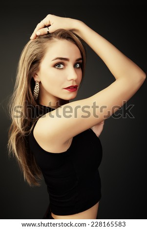 Young beautiful woman portrait with long hair in studio shot. Teen girl beautiful cheerful enjoying.  - stock photo