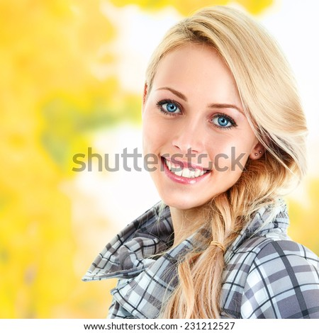 Young beautiful woman posing in autumn park - stock photo