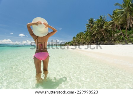 Young beautiful woman posing on the beach. - stock photo