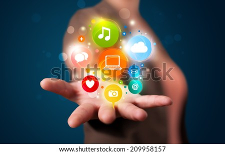 Young beautiful woman presenting colorful technology icons and symbols - stock photo