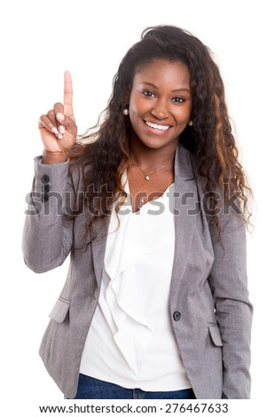 Young beautiful woman presses key, isolated over white - stock photo