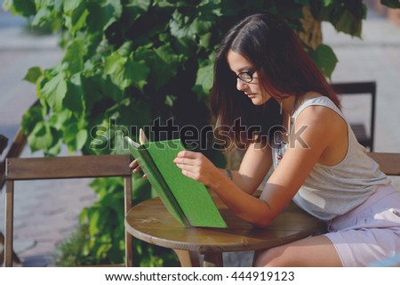 young beautiful woman read a book - stock photo