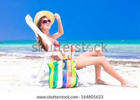 Young beautiful woman relaxing at beach - stock photo