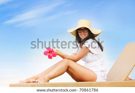 young beautiful woman relaxing isolated on sky background - stock photo