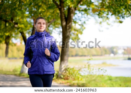 Young Beautiful Woman Running in the Park. Active Lifestyle - stock photo