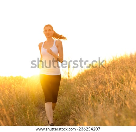 Young Beautiful Woman Running on the Mountain Trail in the Morning. Active Lifestyle - stock photo