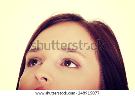 Young beautiful woman's face, cut out composition.  - stock photo