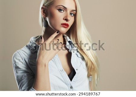young beautiful woman.Sexy Blond girl. Gray Background.Your text here.red lips - stock photo