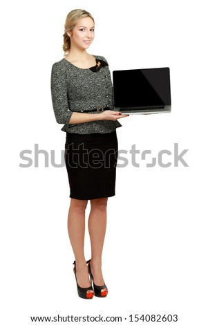 Young beautiful woman showing a laptop, isolated on white background - stock photo