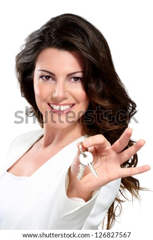 Young beautiful woman showing  apartment keys on white - stock photo