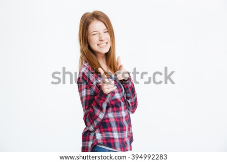 Young beautiful woman showing fingers at camera and winking isolated on a white background - stock photo