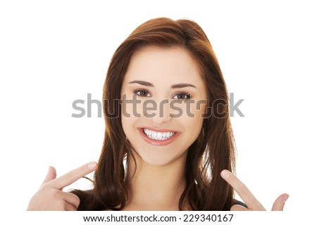 Young beautiful woman showing her teeth - stock photo