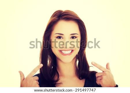 Young beautiful woman showing her teeth - stock photo