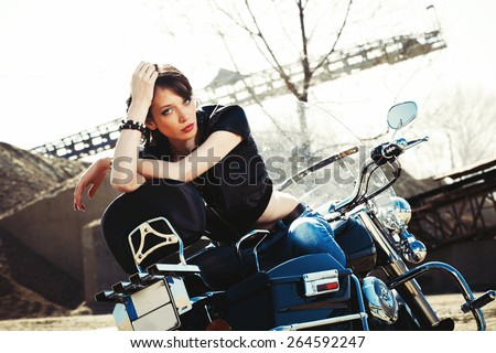 young beautiful woman sitting on motorbike, sunny day outdoor - stock photo