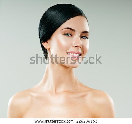 young beautiful woman smiling. perfect skin - stock photo