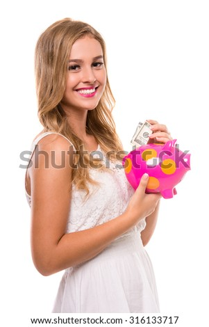 Young beautiful woman standing with piggy bank, isolated on white background. - stock photo