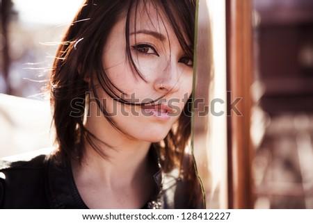 Young beautiful woman staring at camera. - stock photo