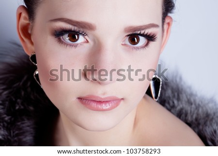 Young beautiful woman studio portrait - stock photo