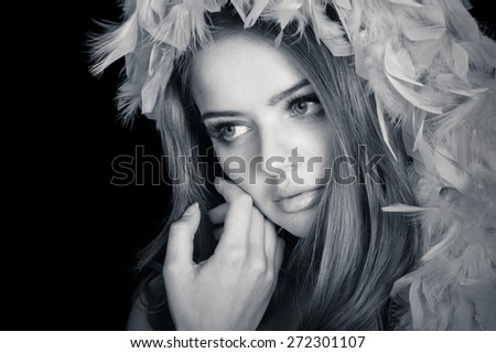 Young beautiful woman thinking, slightly toned black and white portrait  - stock photo