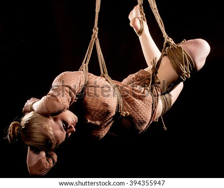 young beautiful woman tied up with rope - stock photo