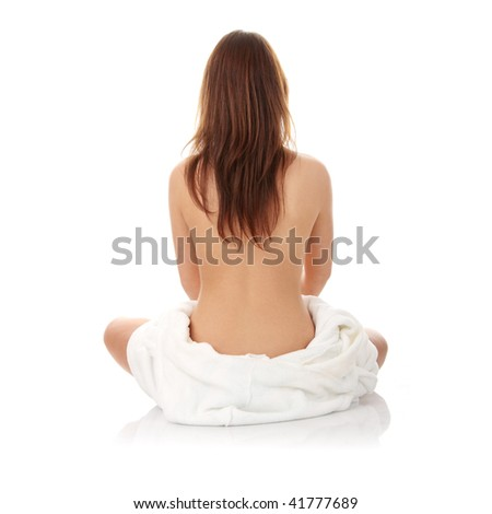Young beautiful woman topless, in towel, view from back, isolated on white background - stock photo