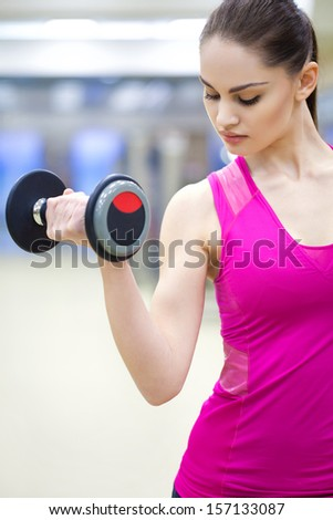 young beautiful woman training in gym - stock photo