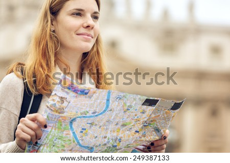 Young beautiful woman traveler with map. - stock photo