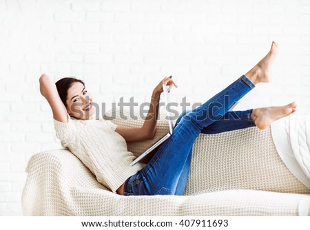 Young beautiful woman using a laptop computer at home - stock photo