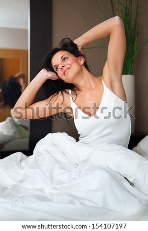 Young beautiful, woman waking up happy and rested. - stock photo
