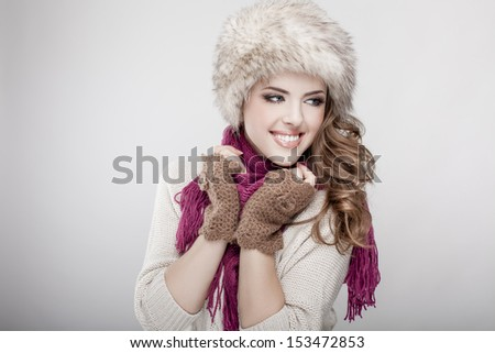 young beautiful woman wearing fur hat and scarf - stock photo