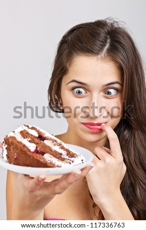 Young beautiful woman with a cake - stock photo