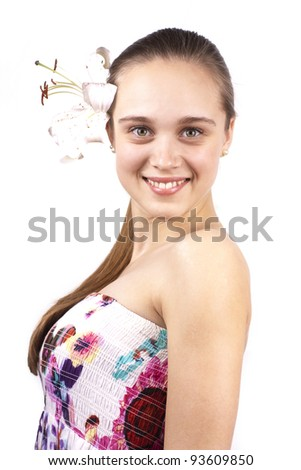young beautiful woman with a flower in hair  isolated on a white background - stock photo