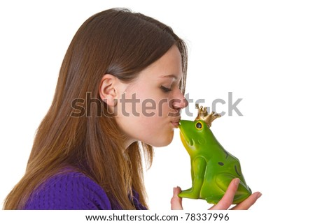 Young beautiful woman with a toy frog prince on white background. - stock photo