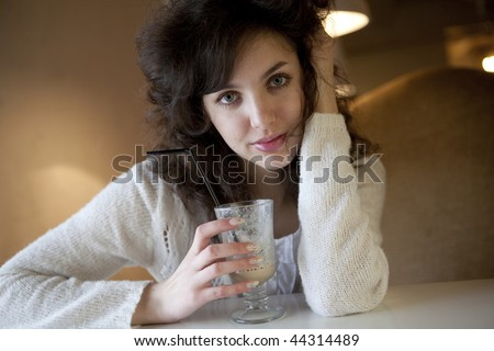 Young beautiful woman with a white cup - stock photo