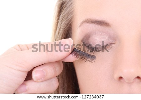 young beautiful woman with artificial eyelashes - stock photo