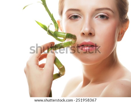young beautiful woman with bamboo, isolated on white - stock photo
