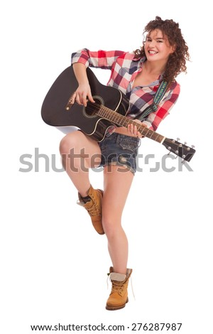 young beautiful woman with black guitar on white background  - stock photo