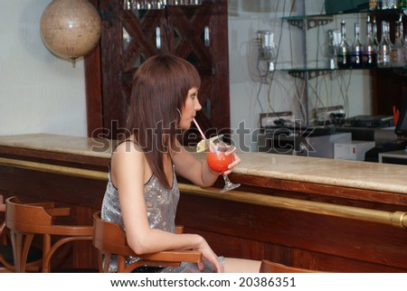 Young beautiful woman with cocktail - stock photo