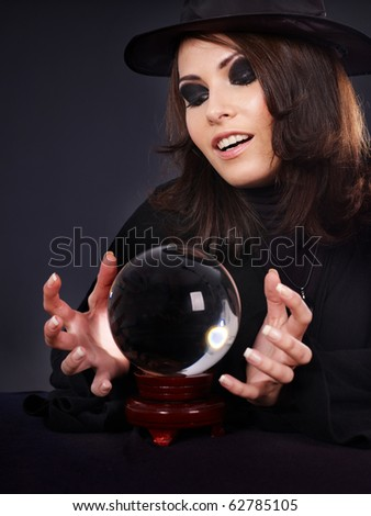 Young  beautiful woman with crystal ball. Fortune telling. - stock photo