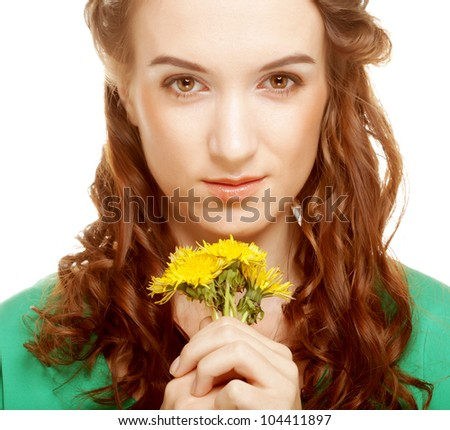 young beautiful woman with dandelion bouquet - stock photo