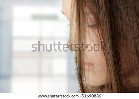 Young beautiful woman with depression - stock photo