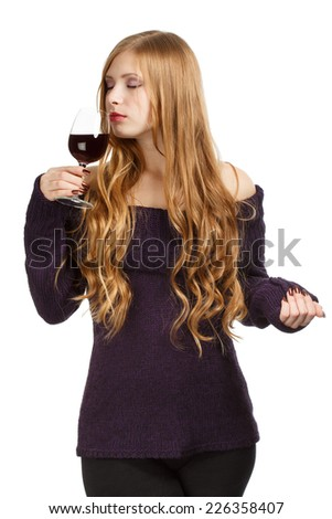 Young beautiful woman with expressive hairstyle and closed eyes holding glass of red wine isolated on white background - stock photo