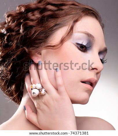 Young, beautiful woman with fashionable jewellery; retro style white coral ring - stock photo