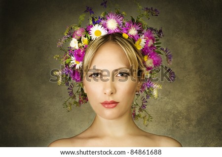 young beautiful woman with  flowers on her head - stock photo