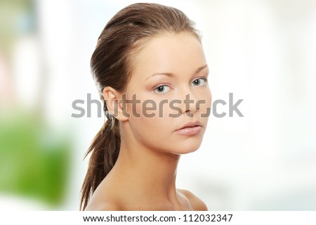 Young beautiful woman with fresh clean skin - stock photo