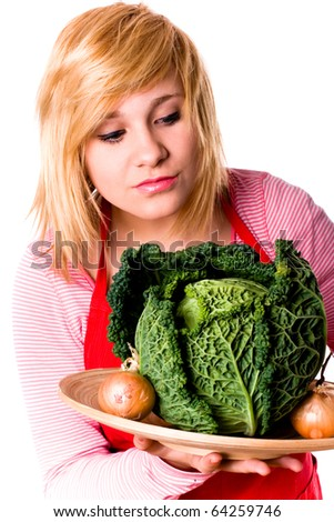 young beautiful woman with fresh savoy cabbage and onions on white background - stock photo