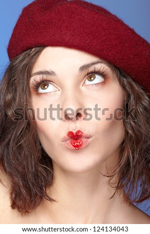 young beautiful woman with heart drawing on lips. Valentine's day - stock photo