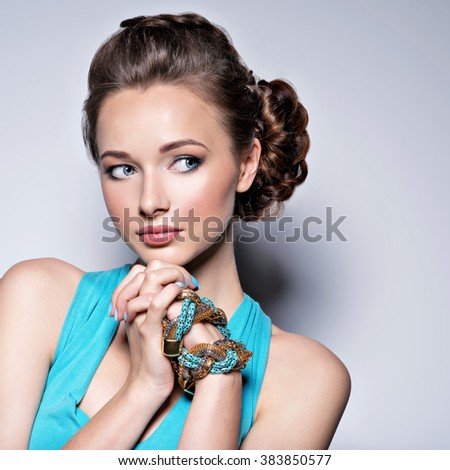 Young beautiful woman with jewelry. - stock photo