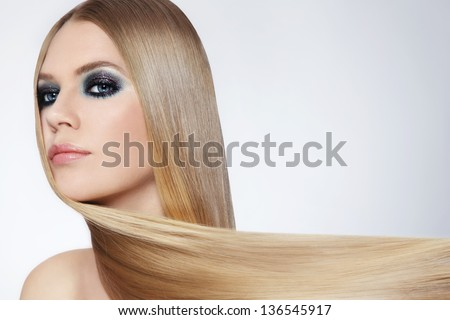 Young beautiful woman with long blond hair - stock photo